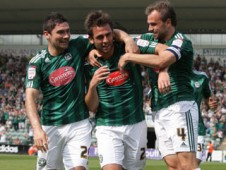 The Argyle players celebrate after Simon Walton scored the only goal of the game.